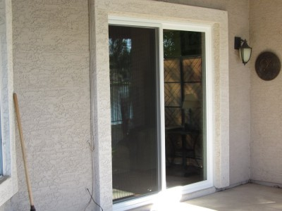 After- New White Vinyl Patio Doors