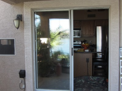 Before- old aluminum patio door